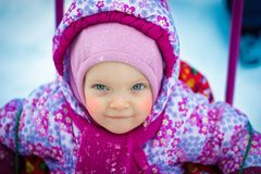 Portrait of young red-cheeked baby Royalty Free Stock Photography