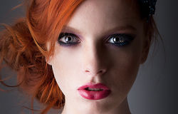 Portrait of young red haired freckled girl closeup stock images