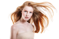 Portrait of a young red-haired girl on a white background Royalty Free Stock Photo