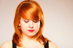 Portrait of young red haired woman. Royalty Free Stock Photos