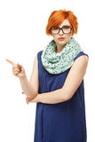 Portrait of a young red-haired woman with a stern expression on Stock Photos