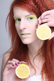 Portrait of young redhaired girl with lemon Stock Images