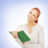 Portrait of a young redhead businesswoman holding a book Stock Images