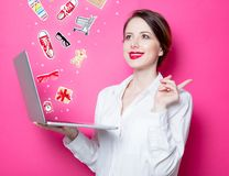 Redhead businesswoman with laptop Stock Photo