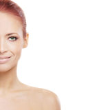 Portrait of a young redhead naked woman. Portrait of a young and attractive redhead Caucasian naked woman in a beautiful makeup. The image is isolated on a white Royalty Free Stock Photography