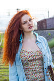 Portrait of young redhead woman stock image