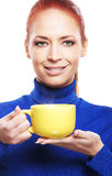 Portrait of a young redhead woman with a cup Stock Images