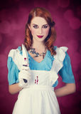 Portrait of a young redhead woman dressed as Alice in Wonderland. Video game stock images