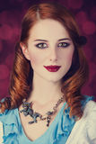Portrait of a young redhead woman. Dressed as Alice in Wonderland, video game royalty free stock image