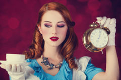 Portrait of a young redhead woman. Dressed as Alice in Wonderland, video game royalty free stock photography