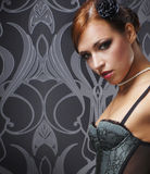 Portrait of a young redhead woman erotic clothes Royalty Free Stock Image