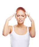 Portrait of a young redhead woman with a headache Stock Photo