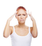 Portrait of a young redhead woman with a headache Royalty Free Stock Photo