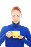 Portrait of a young redhead woman holding a cup Royalty Free Stock Photos
