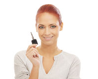Portrait of a young redhead woman holding a key Stock Photography