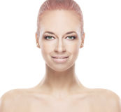 Portrait of a young redhead woman in a makeup. Portrait of a young and attractive redhead Caucasian naked woman posing in a beautiful makeup. The image is Royalty Free Stock Photography