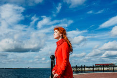 Portrait of young redhead woman in red winter coat Stock Images
