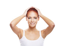 Portrait of a young redhead woman in a white shirt Stock Image