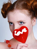 Portrait of young redheaded woman with lollipop Stock Images