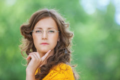 Portrait of young reflective woman Royalty Free Stock Photography