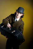 Portrait of young retro gentleman with luggage Royalty Free Stock Image