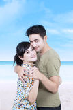 Portrait of young romantic couple on the beach Stock Image