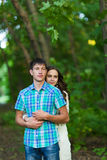 Portrait of a young romantic couple embracing each other on nature Royalty Free Stock Photos