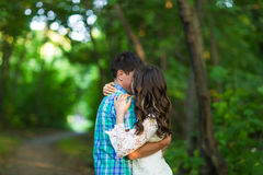 Portrait of a young romantic couple embracing each other on nature Royalty Free Stock Images