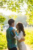 Portrait of a young romantic couple embracing each other on nature Royalty Free Stock Image