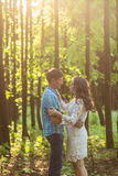 Portrait of a young romantic couple embracing each other on nature Stock Photography