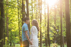 Portrait of a young romantic couple embracing each other on nature Stock Images