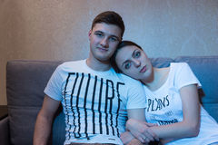 Portrait of young and romantic couple sitting in embrance and wa Royalty Free Stock Photos
