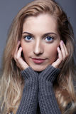 Portrait of young romantic woman in gray woolen sweater. Beautif Royalty Free Stock Photos