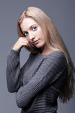 Portrait of young romantic woman in gray woolen sweater. Beautif Stock Images