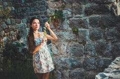 Portrait of young romantic woman with long hair, red lips and manicure in white dress flowers. Attractive girl in Stari Royalty Free Stock Images
