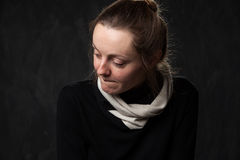 Portrait of a young sad disoriented woman. Grey background Royalty Free Stock Image
