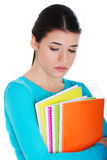 Portrait of young sad female student with workbook. Stock Photo