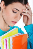 Portrait of young sad female student with workbook. Royalty Free Stock Photos