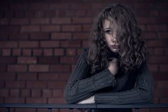 Portrait of a young sad girl. Portrait of a young sad girl at the day time. Concept of sarrow Royalty Free Stock Photos