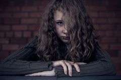 Portrait of a young sad girl. Portrait of a young sad girl outdoors. Concept of sarrow Royalty Free Stock Images