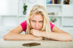 Portrait of young sad girl waiting for call. Closeup portrait of young sad girl waiting for call at home Royalty Free Stock Photo
