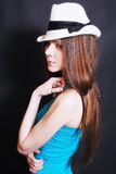Portrait of young sad girl in white hat. On black background Royalty Free Stock Photos