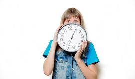 Young sad teenage girl with clock. Portrait of young sad teenage girl with clock on white background stock photos