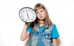 Young sad teenage girl with clock. Portrait of young sad teenage girl with clock on white background stock photo