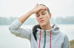 Portrait of a young sad woman  with headache, fatigue or cold. D Stock Photo