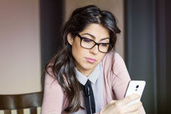 Portrait of young sad woman, receiving bad sms indoor Stock Photography