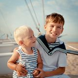 Portrait of young sailor and girl near yacht Stock Image
