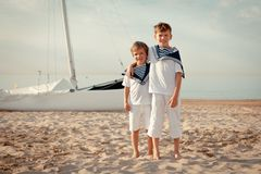 Portrait of young sailors near yacht Royalty Free Stock Images