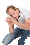 Portrait of young scared man gesturing. Royalty Free Stock Photos