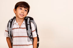 Portrait of young schoolboy looking away stock image